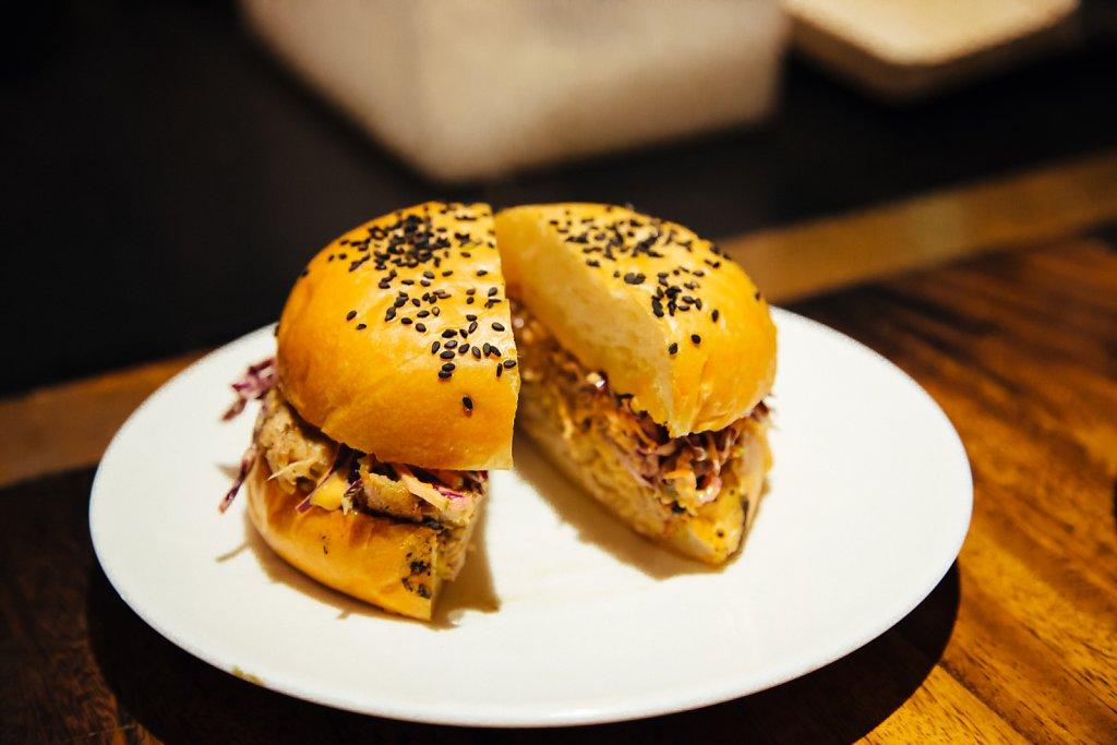 """Burnt Ends' Sanger""; pulled pork shoulder, cole slaw, chipotle aioli and brioche bun"
