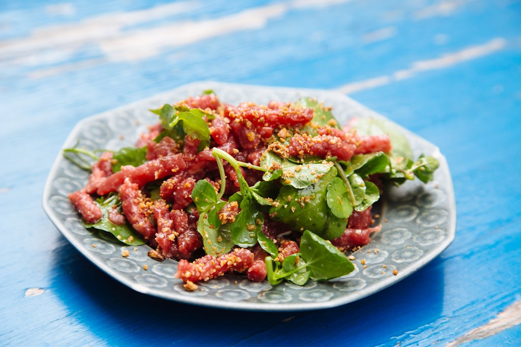 "Beef tartare, with young cress, ""egg cream"" and crumbled rye-bread toasts"
