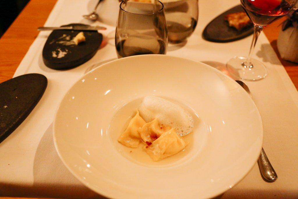 Liquid parmesan ravioli, onion consommé, mild horseradish, pancetta