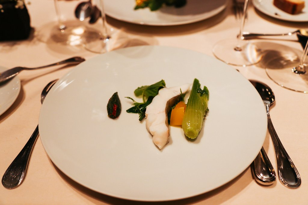 Steamed John Dory with steamed vegetables, heated yuzu, julienned zest of yuzu, a salty herb and powdered cumin