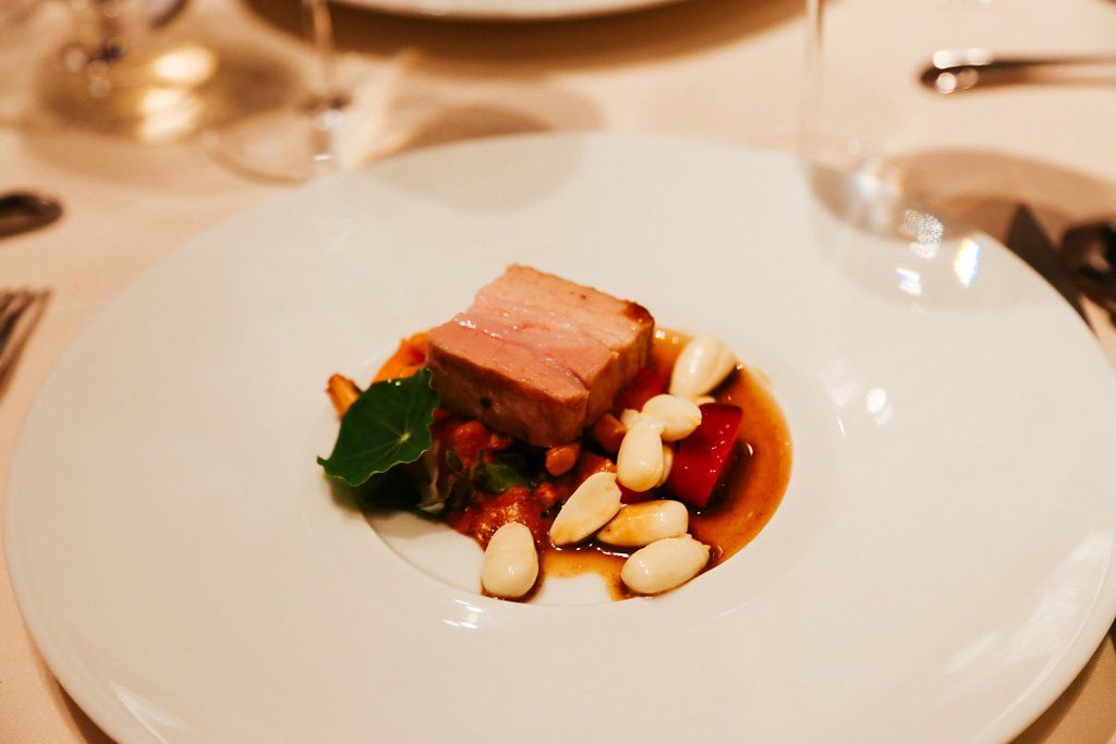 Pork belly confit with chanterelles, raw almonds, and apricots
