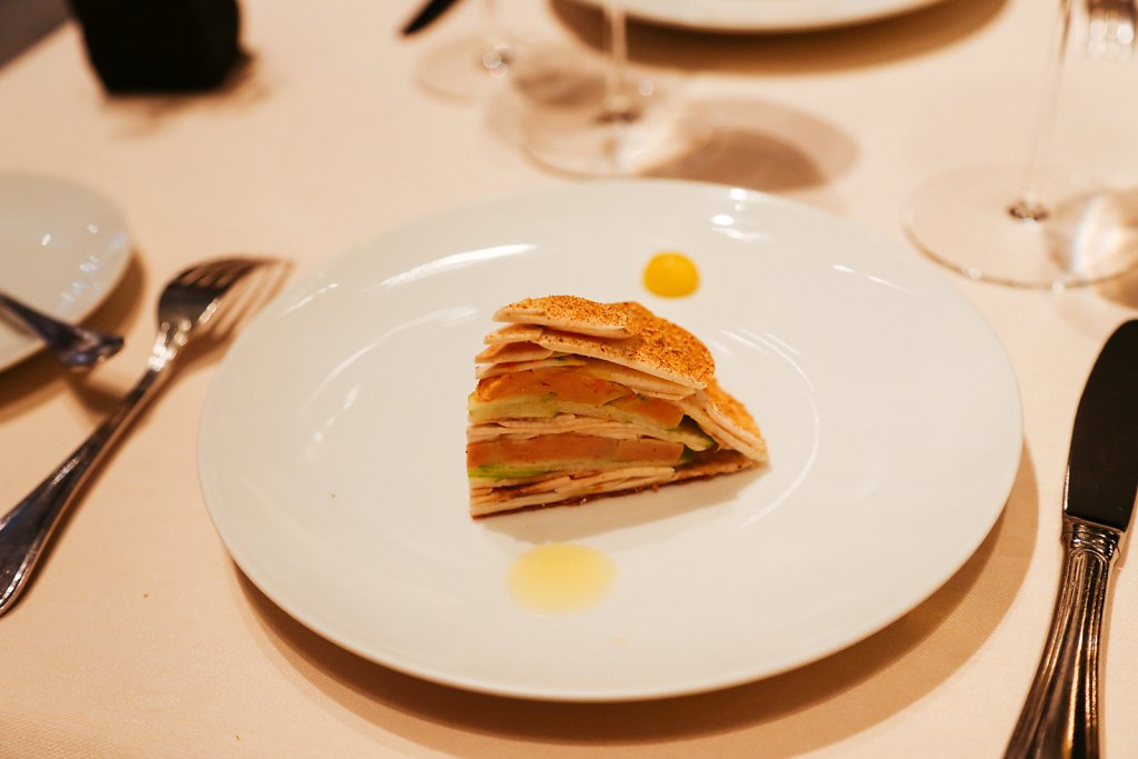 A millefeuille-like galette of foie gras, green apple and mushrooms (all raw); hazelnut vinaigrette and lemon confit