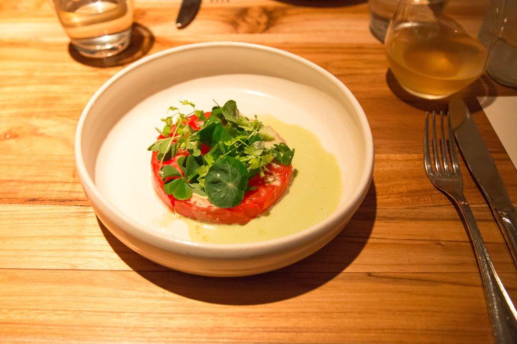 Tomato, leche de tigre and herbs